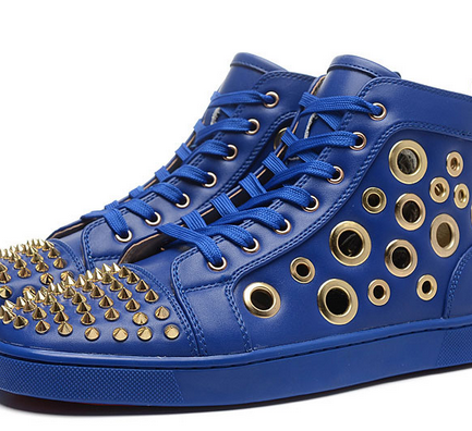 Christian Louboutin blue leather shoes with studs and grommets.