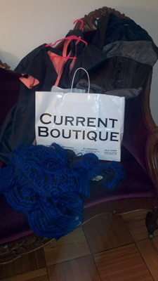 Current Boutique shopping back with dresses.