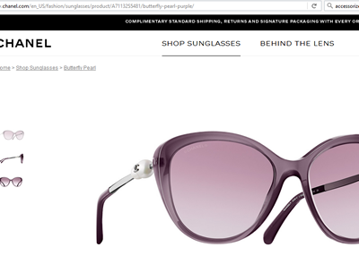 Purple CHANEL shades with pearl handles.