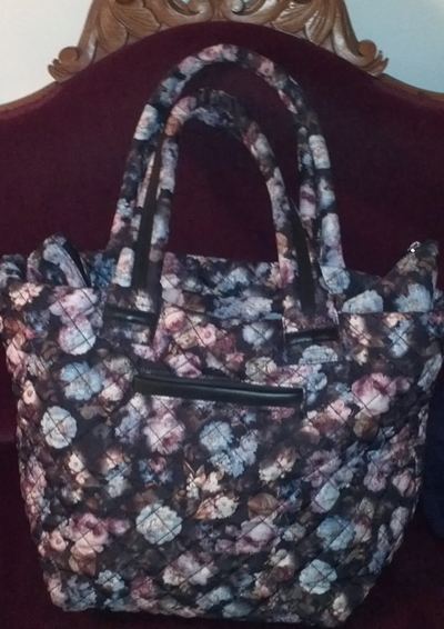 Quilted tote bag with white, blue and pink flowers.