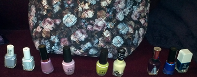 Flower print bag with blue, pink, yellow and green nail polish options.