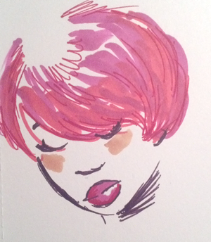 A Black woman with an adorable red bob haircut and matching lipstick.