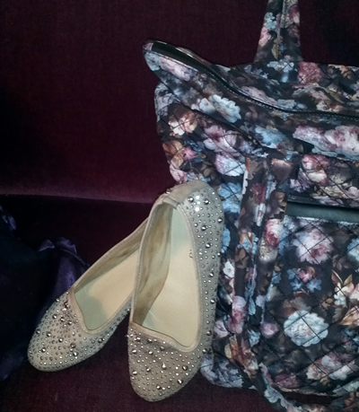 Nude studded shoes with spring flowered bag.