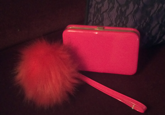 Small pink purse with large fuzzy purse charm.