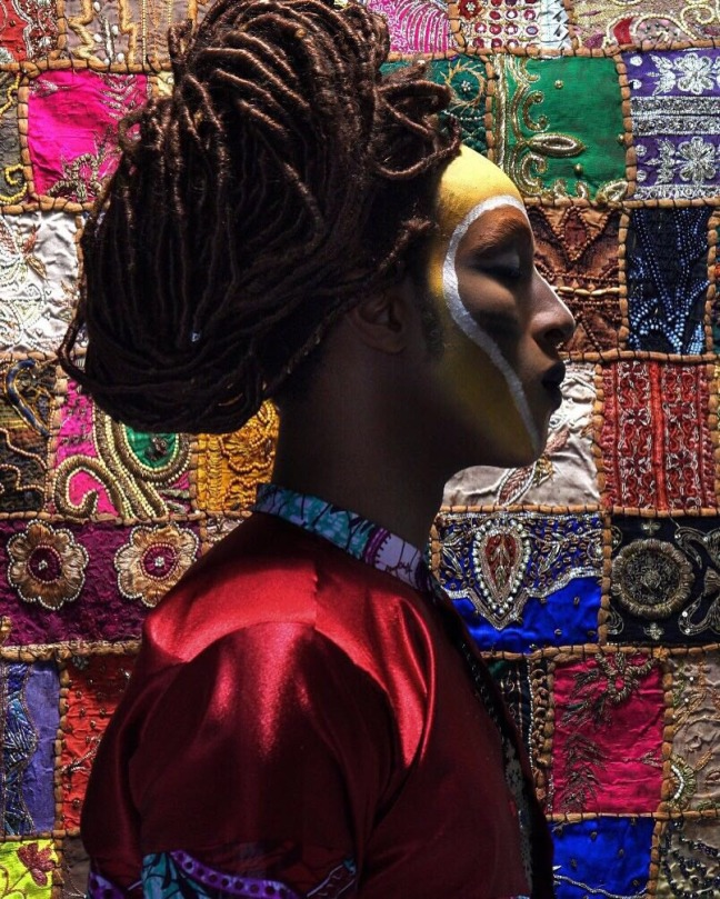 Model in colorful ethnic prints and gold facepaint. Styled by Eugene Simms.