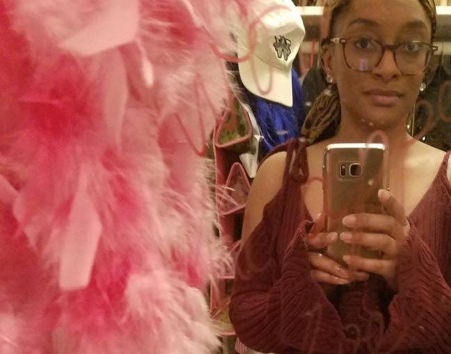 Selfie of me in red shoulder tie sweater in front of mirror