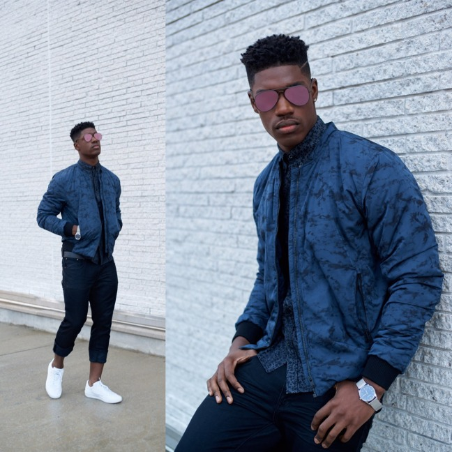 Model in purple shades, blue shirt, jacket and slacks, styled by Eugene Simms.