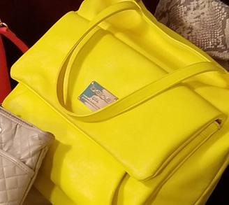 Bright yellow Bebe bag.