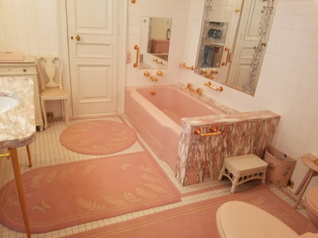 Pink bathroom with pink veined marble bathtub and sink.. The poshest of the posh...