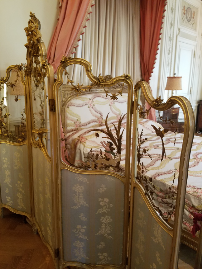 Gorgeous dressing screen in the pink bedroom styled for Post's daughters.